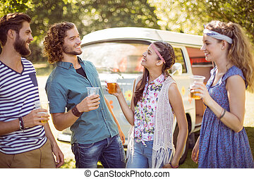 Hipster friends having a beer together