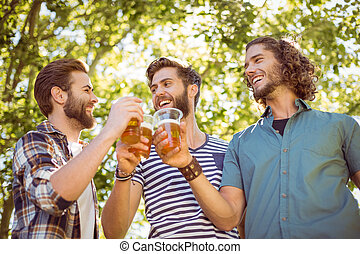 Hipster friends having a beer toge