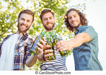 Hipster friends having a beer
