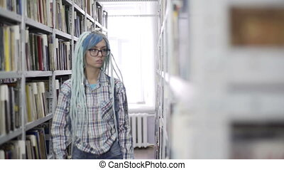 Hipster girl absorbed in reading book in library - Portrait...