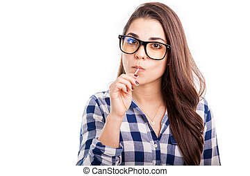 Hipster girl eating a lollipop