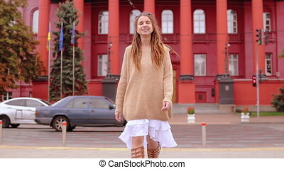 hipster girl goes towards the camera - beautiful young woman...