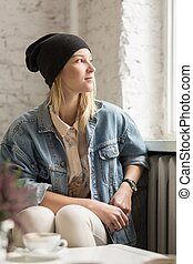 Hipster girl in black cap