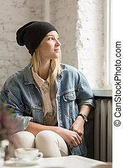 Hipster girl in black cap