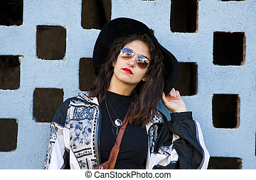 hipster girl on the wall