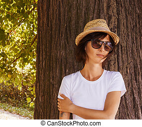 Hipster girl relaxing in the park