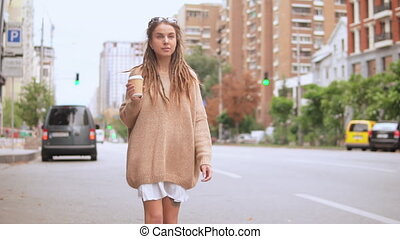 hipster girl stroll in town - young caucasian woman walking ...
