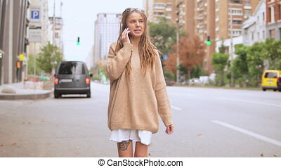 hipster girl talking by phone - young woman use mobile ...