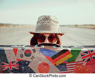 Hipster girl with a suitcase