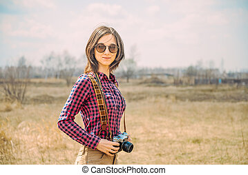 Hipster girl with camera