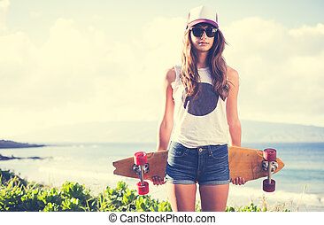 Hipster girl with skate board wearing sunglasses - Beautiful...