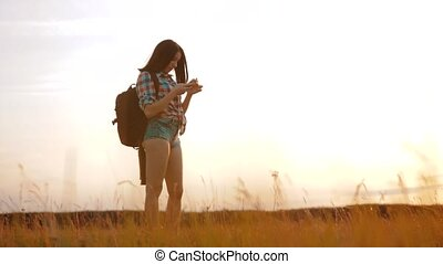 Hipster hiker silhouette girl wanderer search position...