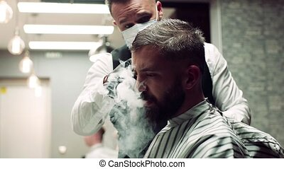 Hipster man client visiting haidresser and hairstylist in...
