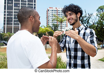 Hipster man in discussion with african american friend