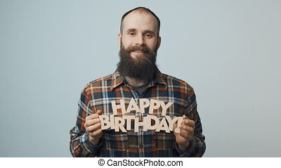 Hipster man showing and giving you a Happy Birthday text -...