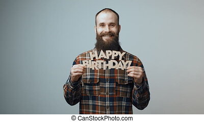 Hipster man showing Happy Birthday banner