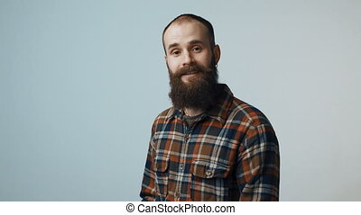 Hipster man showing heart shape - Bearded hipster man...