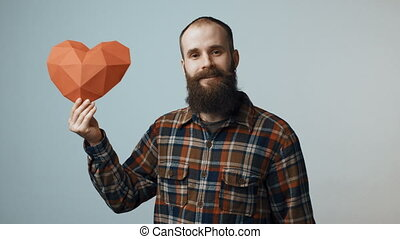 Hipster man showing heart shapes - Bearded hipster man...
