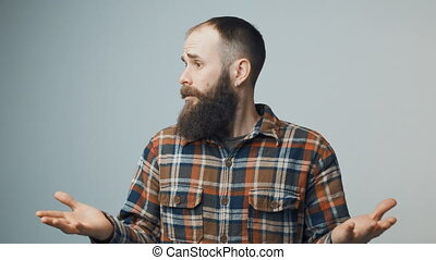 Hipster man spreading hands in wonder