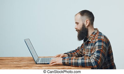 Hipster man working with laptop