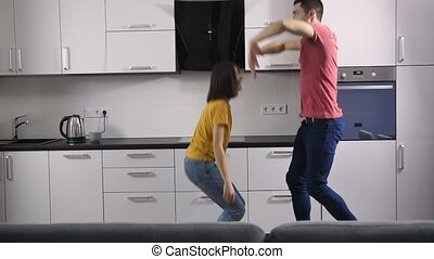 Hipster newlyweds celebrating at home with dance