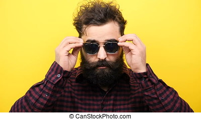 Hipster puts his glasses on the face - Slow motion of...