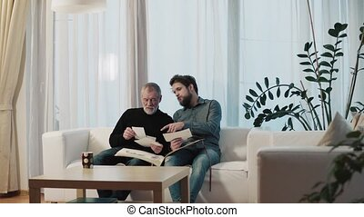 Hipster son and his senior father at home. - Hipster son and...