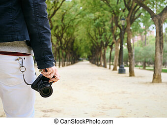 Hipster Street Photographer Walking With Mirrorless Camera In Hand