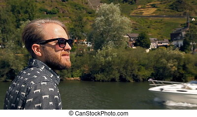 Hipster tourist is sailing on a ship