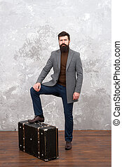 Hipster traveler with baggage. Ready for relocation with baggage. Start journey. On way to new life. Luggage insurance. Man well groomed bearded hipster with big suitcase. Travel and baggage concept