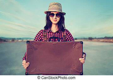 Hipster traveler with suitcase