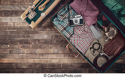 Hipster traveler's suitcase
