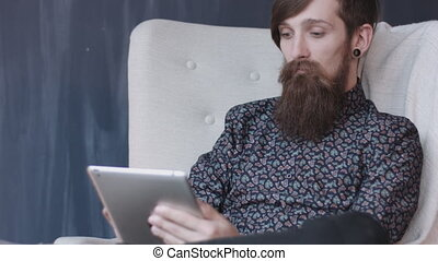 Hipster using digital tablet.