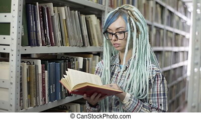 Hipster woman in library searching for a book and listing...