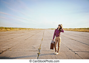 Hipster woman with suitcase
