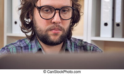 hipster working with laptop at workplace