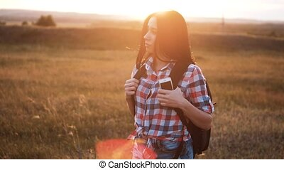 Hipster young girl walk with backpack smartphone enjoying...