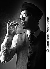 Hipster young man smoking cigar