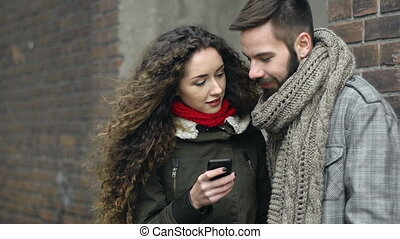 Hipsters Outdoors - Close up of young couple standing in the...