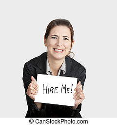 Hire me please!!! - Business woman holding a card board with...
