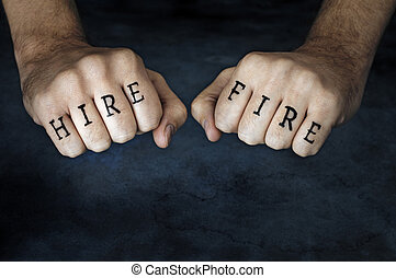 "Hire or Fire? - Conceptual image of a man with ""HIRE"" and..."