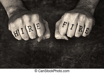 """Monochrome sepia toned conceptual image of a man with """"HIRE"""" and """"FIRE"""" fake tattoos."""
