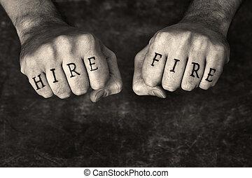 Hire or Fire? - Monochrome sepia toned conceptual image of a...