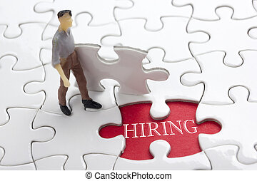 HIRING concept.  Missing Piece Jigsaw Puzzle with word