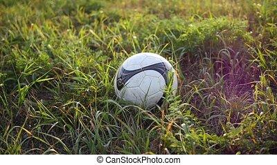 feet hit a soccer ball close up - his feet hit a soccer ball...