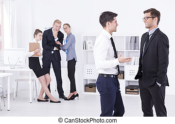 His first day in a new job - Two elegant men talking in a...
