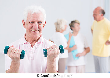 His way of staying fit in old age - Portrait of a smiling...