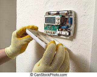 Hispanic air conditioning repair man performing maintenance