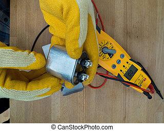 Hispanic aircon maintenance man