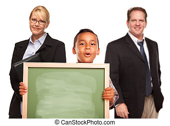 Hispanic Boy Holding Chalk Board with Teachers Behind